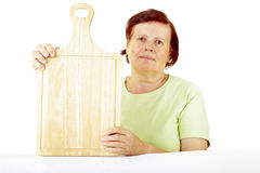 Woman with cutting board Royalty Free Stock Photo
