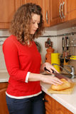 Woman cutting bread Royalty Free Stock Photo