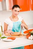 Woman cutting bread on the kitchen Royalty Free Stock Photography