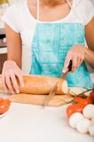 Woman cutting bread on the kitchen Royalty Free Stock Photo