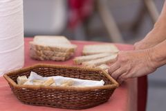 Woman cutting bread in a Spanish market. Horizontal shot Stock Image