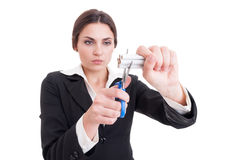 Woman cutting a bunch of cigarettes using scissors or shears. Beautiful young business woman cutting a hand of cigarettes using scissors or shears isolated on Stock Photography