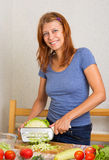Woman cutting cabbage Royalty Free Stock Images