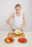 Woman cutting cabbage Stock Photography