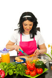 Woman cutting carrot Royalty Free Stock Images