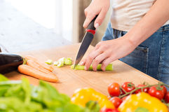 Woman Cutting Celery On Chopping Board Royalty Free Stock Photos