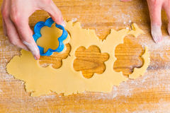 Woman cutting christmas cookies Stock Photo