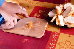 Woman cutting crescent roll Stock Images