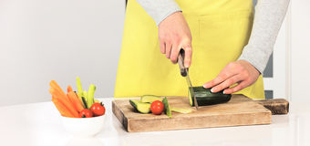 Woman cutting cucumber Royalty Free Stock Image