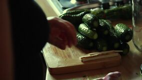 Woman cutting cucumber to prepare fruit salad pickle in the kitchen shelf