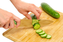 Woman cutting cucumber Royalty Free Stock Image