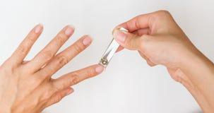 Woman cutting fingernail. Stock Photography