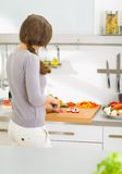 Woman cutting fresh vegetables in modern kitchen Stock Image