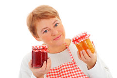 Woman cutting fruit and canning Royalty Free Stock Photography