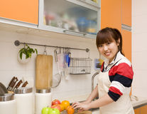 Woman cutting fruits. Stock Photo