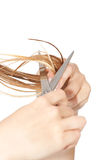 Woman cutting hair. Close-up on white isolated background Royalty Free Stock Photo