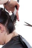 Woman cutting hair stock photos