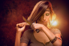 Woman Cutting Hair With Combat Knife Royalty Free Stock Photography