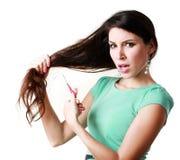 Woman cutting hair Stock Photography
