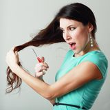 Woman cutting hair Royalty Free Stock Photography