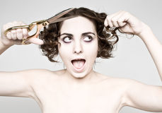 Woman cutting her hair Stock Photography