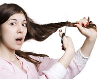 Woman is cutting her hair Stock Image