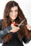 Woman is cutting her hair Stock Images