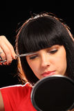 Woman cutting her hair Stock Image