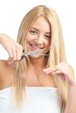 Woman cutting her hair with scissors Royalty Free Stock Images