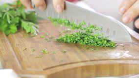 Woman cutting herbs stock video footage