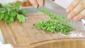 Woman cutting herbs stock video