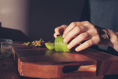 Woman cutting a kiwi Royalty Free Stock Photo