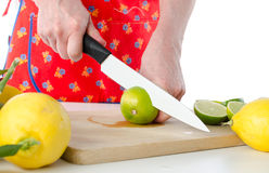 Woman cutting a lime in half Royalty Free Stock Image
