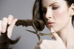 Woman Cutting Long Brown Hair Stock Images