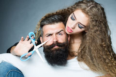 Woman cutting man's beard Royalty Free Stock Photo