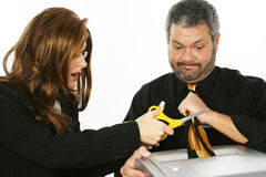 Woman Cutting Man's Tie Royalty Free Stock Images