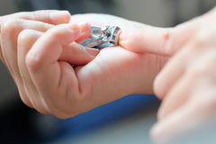 Woman cutting nails Stock Photos
