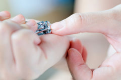 Woman cutting nails Royalty Free Stock Images