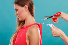 Woman cutting off removing label board price tag. Royalty Free Stock Photo