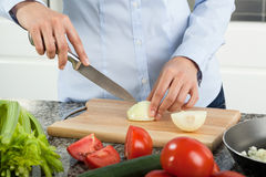 Woman cutting onion Stock Photo
