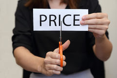 Woman cutting paper of price word Stock Photo