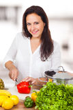 Woman is cutting a paprika Royalty Free Stock Image