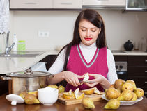 Woman cutting pears for pear jam Stock Images