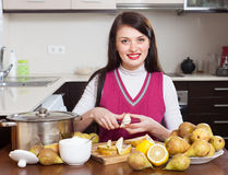 Woman cutting pears for pear jam Royalty Free Stock Photo