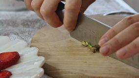 Woman cutting pistachio stock video