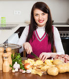 Woman  cutting potatoes Stock Photo