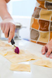 Woman cutting ravioli Royalty Free Stock Photography