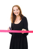 Woman cutting a red ribbon Royalty Free Stock Image