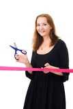 Woman cutting a red ribbon Stock Photography