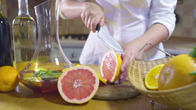 Woman cutting slices of grapefruit slow motion stock video footage